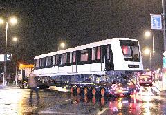 Tolatva kell beállni a telephelyre, ehhez a manőverhez le kell zárni az utat., Fehér út, Budapest (forrás: Hajtó Bálint)